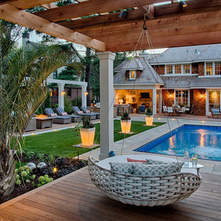 Beach style backyard garden in Minneapolis with a water feature and decking for summer.