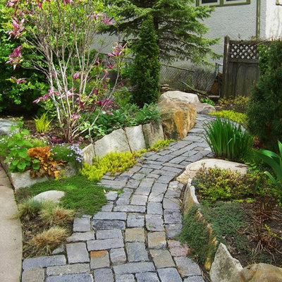 This is an example of a traditional full sun front yard stone garden path in Minneapolis.