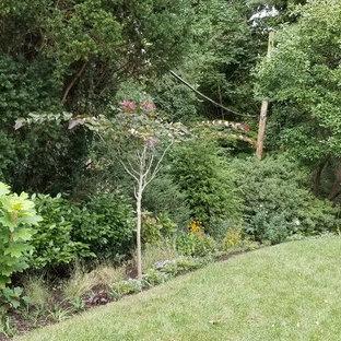 Inspiration for a large transitional full sun backyard formal garden in Philadelphia for fall.