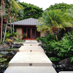 Inspiration for a large tropical partial sun courtyard stone pond in Hawaii.