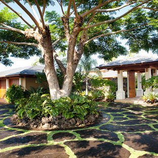 Inspiration for a large tropical shade front yard stone driveway in Hawaii.