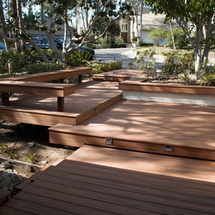 This is an example of a large contemporary full sun backyard landscaping in Los Angeles with decking for summer.