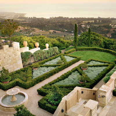 This is an example of a mid-sized mediterranean full sun backyard gravel formal garden in San Francisco.