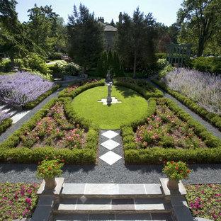 Photo of a large victorian partial sun backyard gravel formal garden in Chicago.