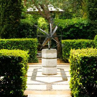 Design ideas for a mediterranean courtyard formal garden in Los Angeles.