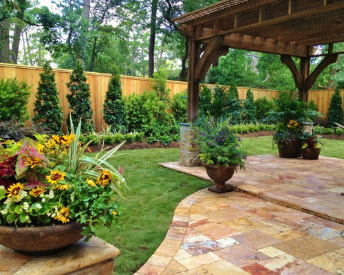 inspiration for a large traditional partial sun courtyard stone formal garden in houston for summer