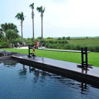 Photo of a large traditional backyard landscaping in Charleston with decking.