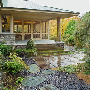 Design ideas for an asian backyard stone landscaping in Burlington for fall.