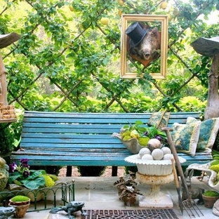 Inspiration for an eclectic partial sun landscaping in Other.