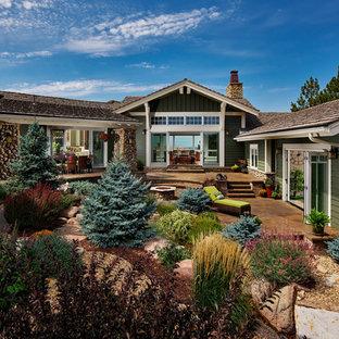 Photo of a craftsman full sun backyard landscaping in Denver.