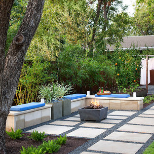 Inspiration for a contemporary partial sun concrete paver landscaping in Austin with a fire pit.