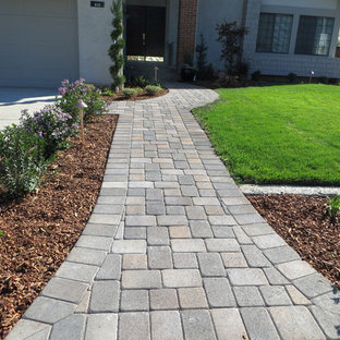 Design ideas for a large traditional front yard concrete paver driveway in San Francisco.