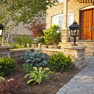 Inspiration for a large traditional partial sun front yard mulch landscaping in Toronto.