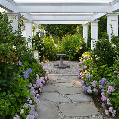 Photo of a traditional side yard stone garden path in New York.
