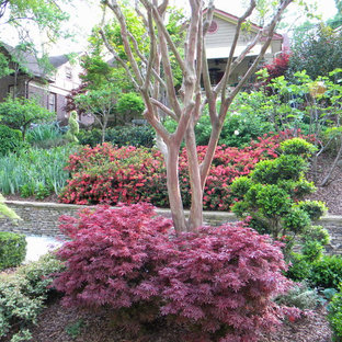 Inspiration for a traditional sloped garden in Atlanta.