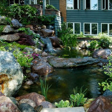 Traditional Landscape by Grant and Power Landscaping