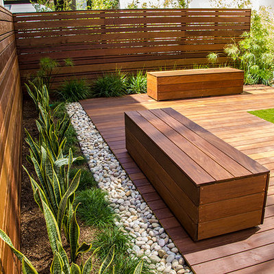 Photo of a large contemporary drought-tolerant and full sun backyard landscaping in Orange County with decking.