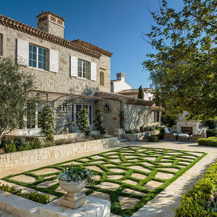Inspiration for a mediterranean stone landscaping in Orange County with a fireplace.
