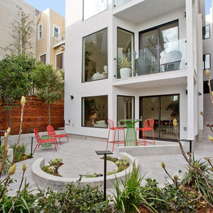 This is an example of a small contemporary partial sun backyard stone formal garden in San Francisco.