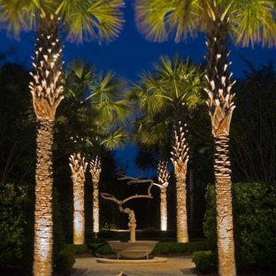 Inspiration pour un grand jardin avant ethnique avec une entrée ou une allée de jardin et des pavés en béton.