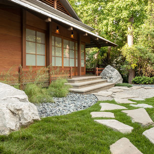 Inspiration for a mid-sized asian partial sun side yard stone garden path in Houston.