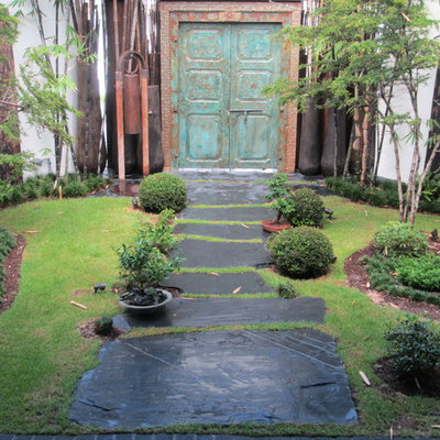 This is an example of a mid-sized asian shade front yard garden path in Miami.