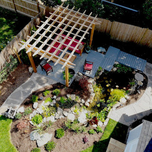 Inspiration for a small asian partial sun backyard pond in Providence with decking for summer.