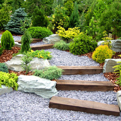 Photo of a traditional hillside gravel garden path in New York.