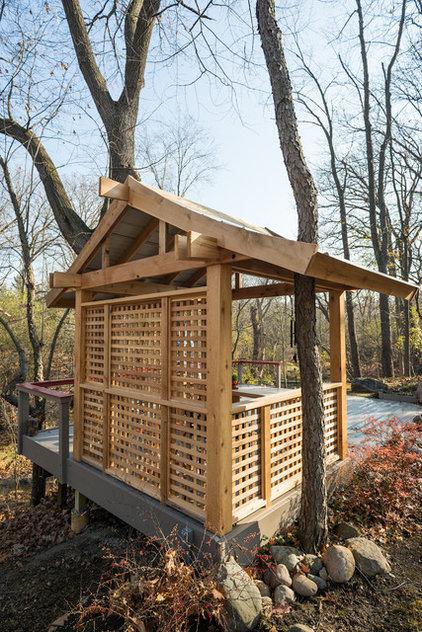 Traditional Landscape by Elemental Design & Bloom Garden Center