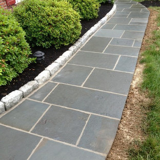 Inspiration for a large traditional full sun side yard stone landscaping in Philadelphia for fall.