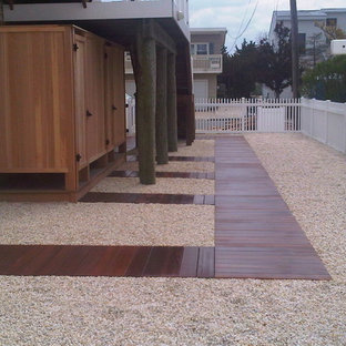 Photo of a modern full sun side yard landscaping in New York with decking for summer.