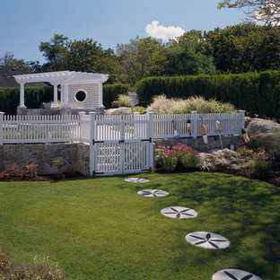 This is an example of a large beach style full sun side yard stone garden path in Boston for summer.
