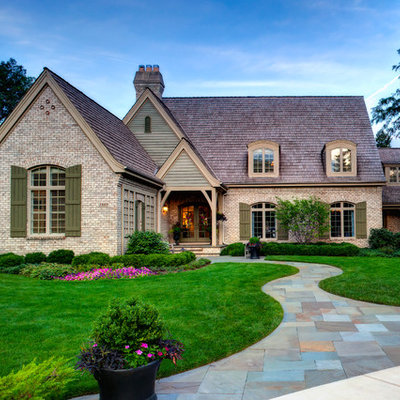 Design ideas for a large traditional partial sun front yard stone landscaping in Chicago.