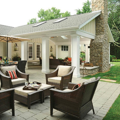 Design ideas for a huge traditional full sun backyard brick landscaping in Columbus with a fire pit for fall.