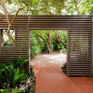 This is an example of a world-inspired side garden in Portland with brick paving and a garden path.