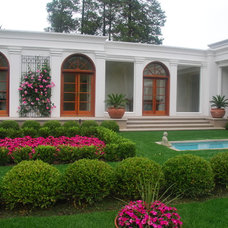 Traditional Landscape by Alan Cooper Architect, PLLC