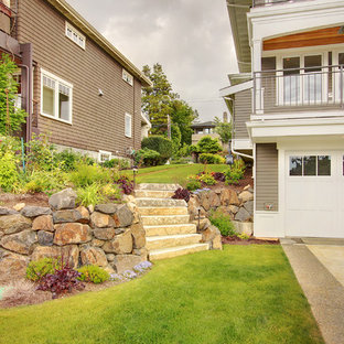 Design ideas for a large craftsman side yard retaining wall landscape in Seattle.