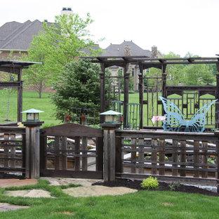 Design ideas for a large craftsman full sun backyard vegetable garden landscape in Indianapolis for summer.
