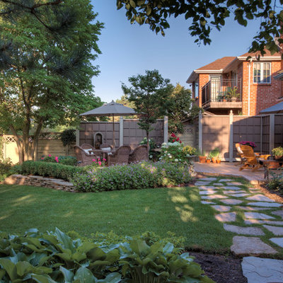 Photo of a traditional backyard landscaping in Toronto.
