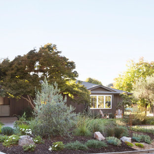 This is an example of a transitional front yard concrete paver formal garden.