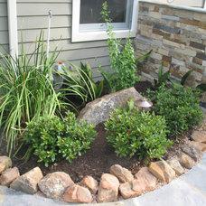 Traditional Landscape by GreenTex Builders LLC