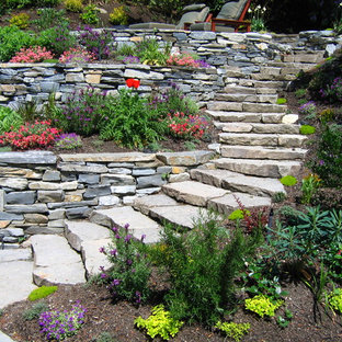 This is an example of a contemporary hillside retaining wall landscape in Seattle.