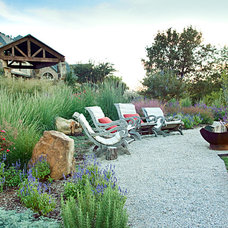 Rustic Landscape by One Specialty Landscape Design, Pools & Hardscape