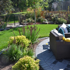 Transitional Patio by Prairie Outpost Garden Design INC.