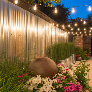 Inspiration for a small eclectic full sun side yard concrete paver garden path in Dallas for fall.