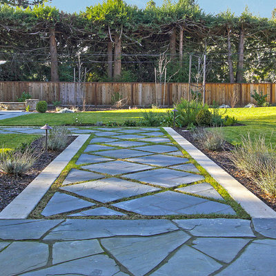 Inspiration for a mediterranean backyard stone landscaping in Other.