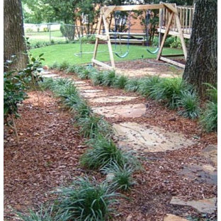 Photo of a mid-sized traditional partial sun backyard stone outdoor playset in Atlanta.