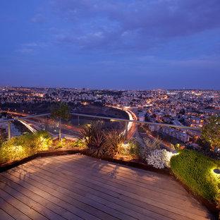Esempio di un giardino minimal sul tetto