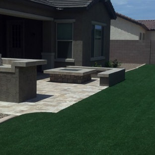 This is an example of a large southwestern drought-tolerant and full sun backyard stone landscaping in Phoenix for summer.