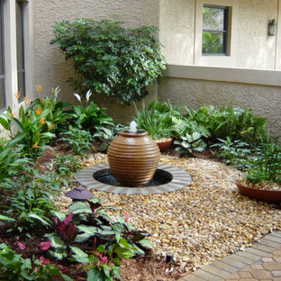 Photo of a small tropical partial sun front yard gravel water fountain landscape in Miami.